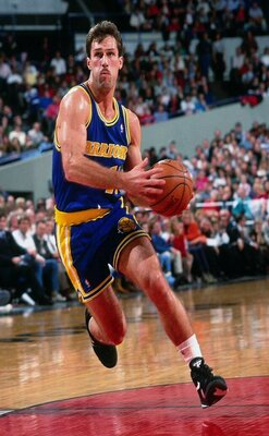 European Players photo of Sarunas Marciulionis in action on the court, running with the ball held with both hands in front