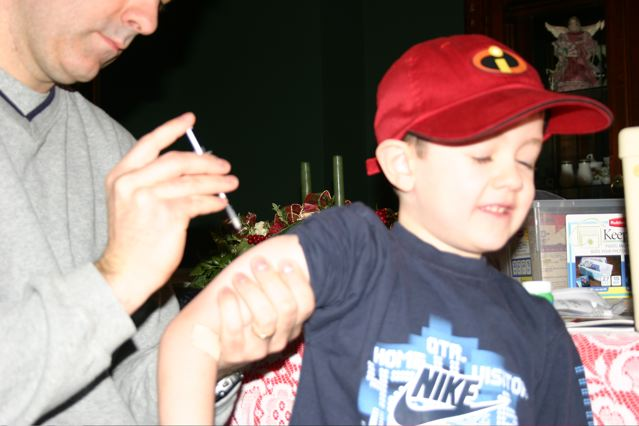 Injecting Caleb with insulin within days of diagnosis.