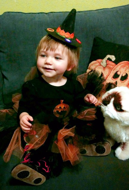 A li'l witch and her (grumpy) cat!