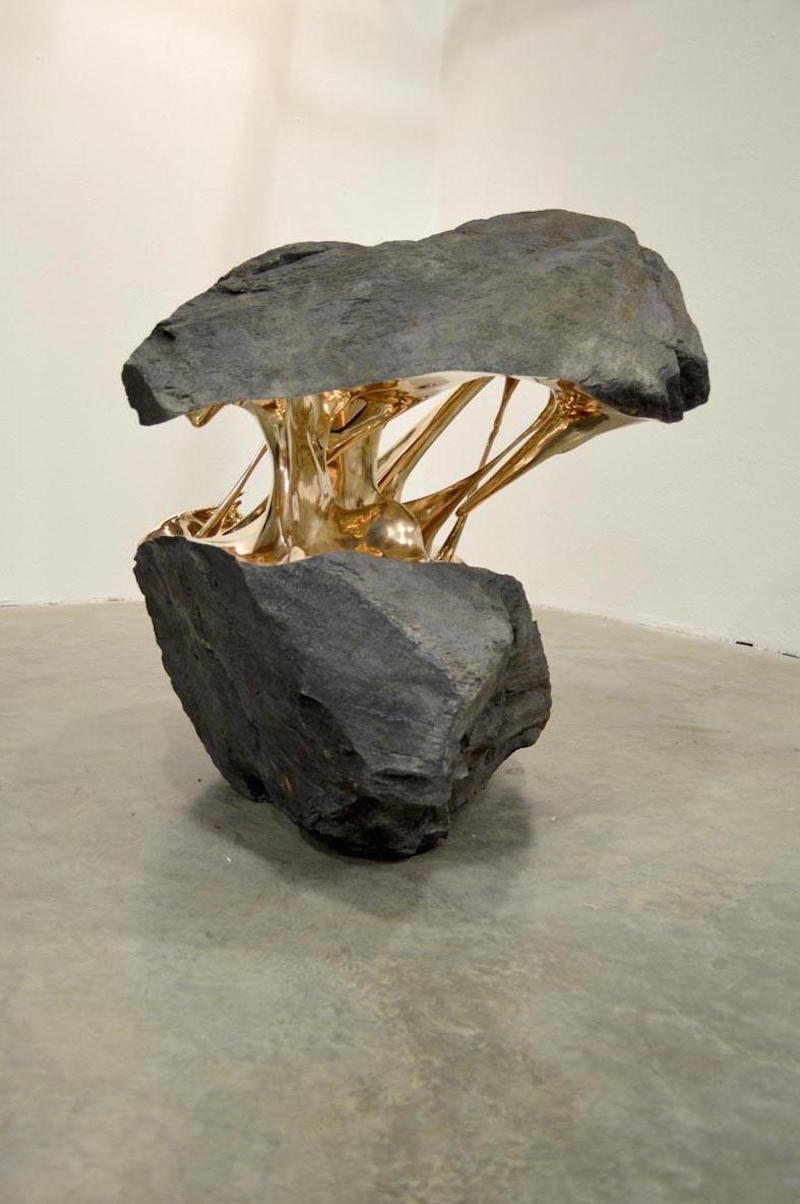 Bisected Boulders With Stretched Bronze Interiors By