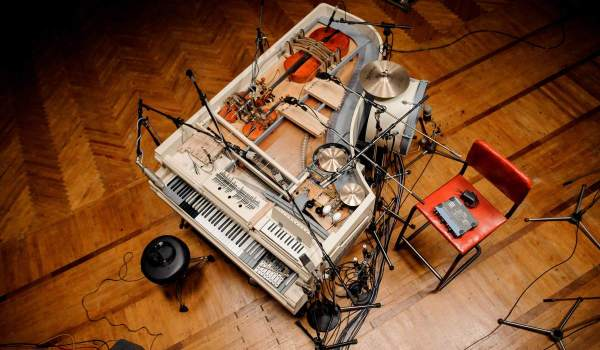 See Band Transform Broken Grand Piano Into 20-Piece Instrument