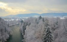 Frosty river with Zurich as a background; viewed from EuroStar.