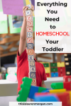 Toddler stacking blocks in a homeschool classroom