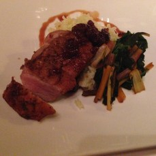 Roasted duck breast with bamboo rice, swiss chard, and cherry gastrique