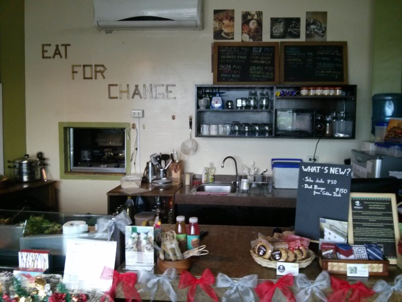 "The Enchanted Farm Cafe invites you to ""Eat for Change""."