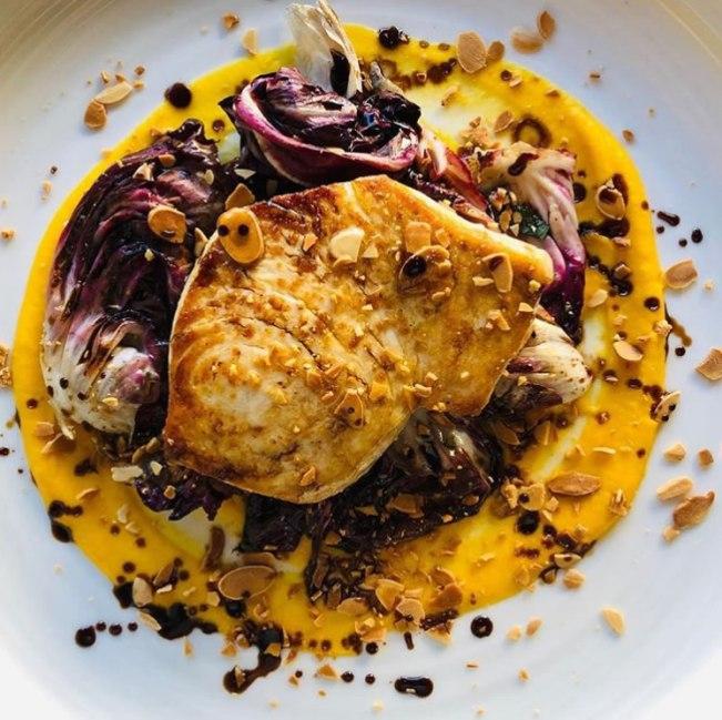 Roasted swordfish with grilled radicchio, squash, almonds and Sicilian oregano