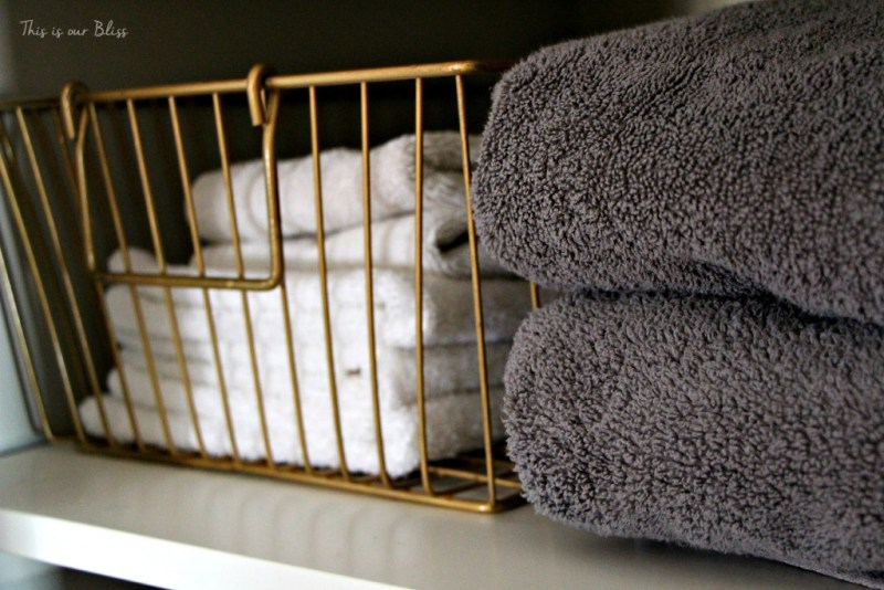 Linen closet makeover - gold basket - declutter & organize - This is our Bliss