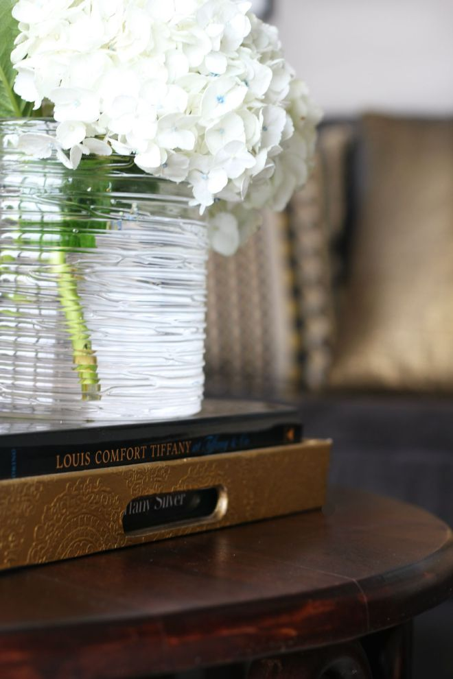 How to style a coffee table - coffee table styling - elements of a well-styled coffee table - Living room couch 1 - gold pillows - Back to Basics - This is our Bliss