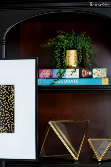 how to update an old bookcase with command hooks - 30 second makeover - formal living room bookcase - hanging art on a bookcase - shelf styling - This is our bliss