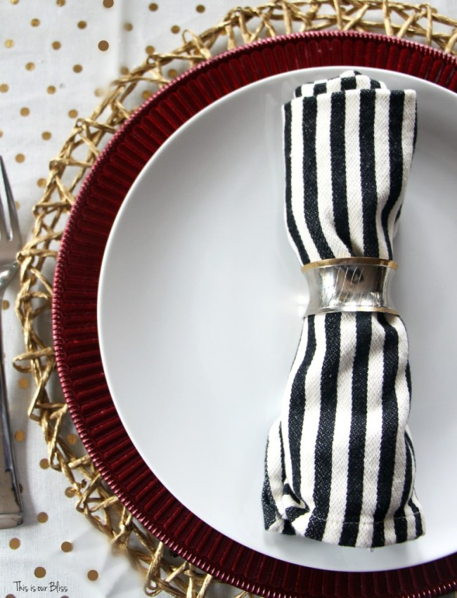 gold polka dot - red ruffle charger plate - black and ivory striped napkin merry bright and blissful holiday home christmas table - thisisourbliss.com