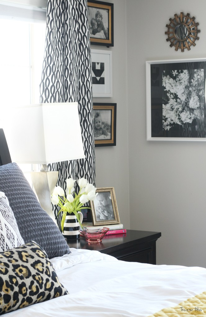 New year new room master bedroom refresh black and white curtains with corner gallery wall with black, white and gold frames leopard pillow This is our Bliss www.thisisourbliss.com