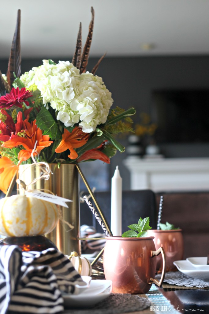Adding a feather to your floral centerpiece instantly updates it for fall!   How to create a warm and welcoming fall tablescape   This is our Bliss   www.thisisourbliss.com