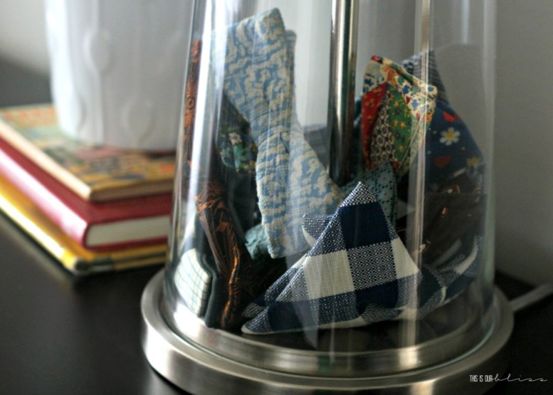 vintage bow ties in a clear fillable lamp   This is our Bliss