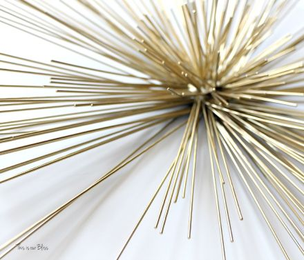 layered wall art - gold urchin - gold urchin on top of metal circles piece - unique wall hanging - This is our Bliss