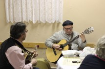 Pastor Roger Parrish-Sigglekow, and Fred Keller playing music at the event