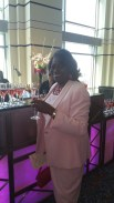 "Barbara Holston sipping ""pink"" champage at Puttin' on the Pink"