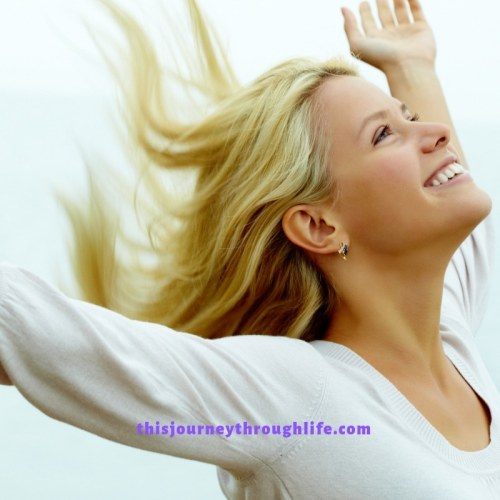 woman happy, smiling, looking up - TJTL - weight loss and increased energy information
