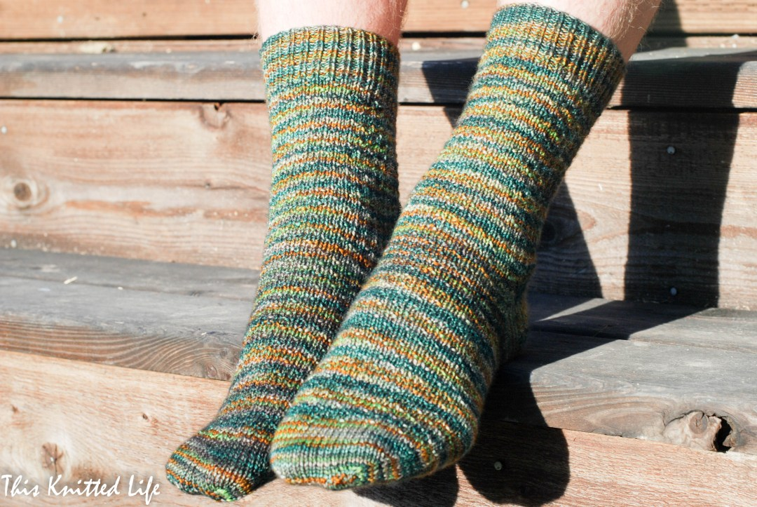 Man socks. Hermione's Every Day sock pattern. Free on Ravelry. Knit in Madelinetosh Tosh Sock in the Plaid Blanket colorway.