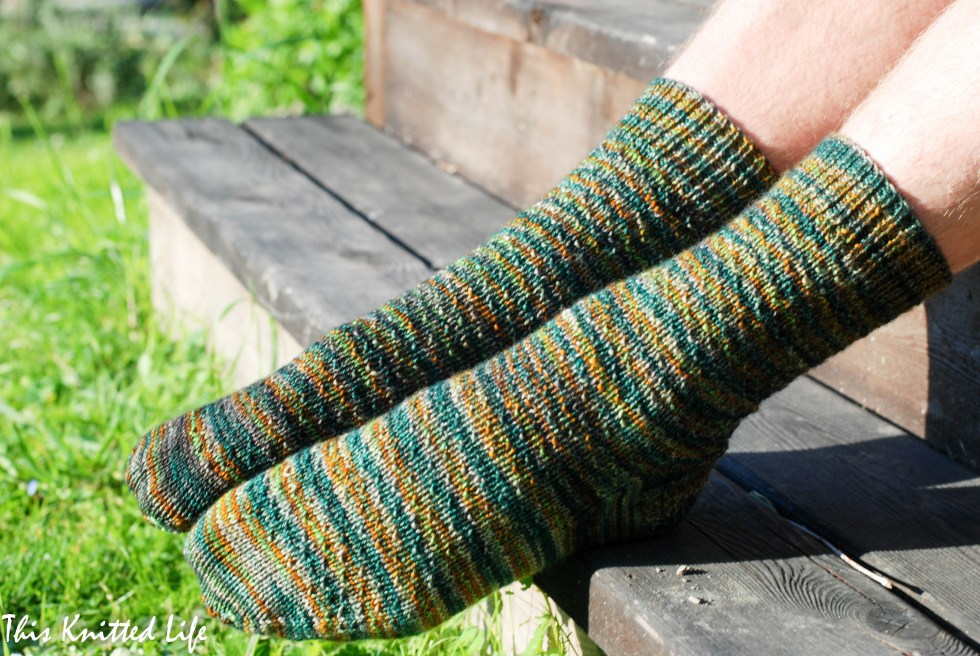 Man socks! Hermione's Every Day socks. Free pattern on Ravelry. Show in Madelinetosh Tosh Sock in the Plaid Blanket colorway.