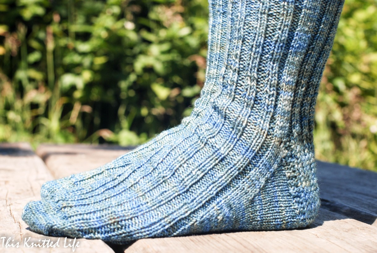 One knitter reflects on her first year of knitting socks. This pair: a basic rib.