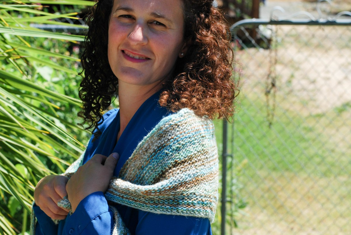 A simple crescent-shaped shawlette knit with handspun yarn.