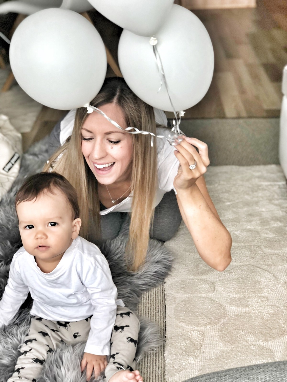 mom and baby with balloons