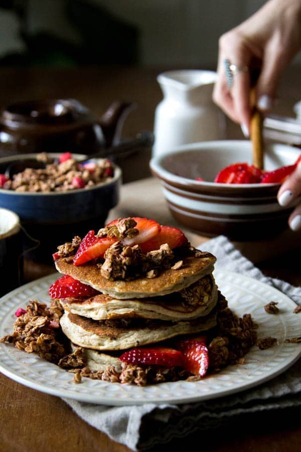 Mixed Berry and Chocolate Crunch Cakes recipe || Tender pancakes filled with chocolate chunks, mixed dried berries and granola clusters ten topped with vanilla scented macerated berries; brunch perfection! || @thismessisours @naturespath