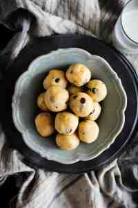 Peanut Butter Chocolate Chip Cookie Dough Bites recipe || Who doesn't love cookie dough?! Honestly, I think we like the dough more than the actual cookies which is why we created this egg free, no bake recipe that makes indulging in the best part of the cookie making process worry free! || @thismessisours #ad @cloversonoma #glutenfree #vegetarian #CheersToTraditions