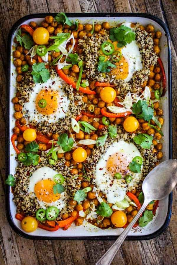 Sheet-Pan Indian Spiced Chickpeas and Eggs recipe    This easy weeknight dinner comes together quickly with minimum hands on time for busy weeknights. toss in shredded rotisserie chicken for for the meat eaters at your table or leave as as for meatless Monday!    @thismessisours #TrendingInTheKitchen @pompeian #ad