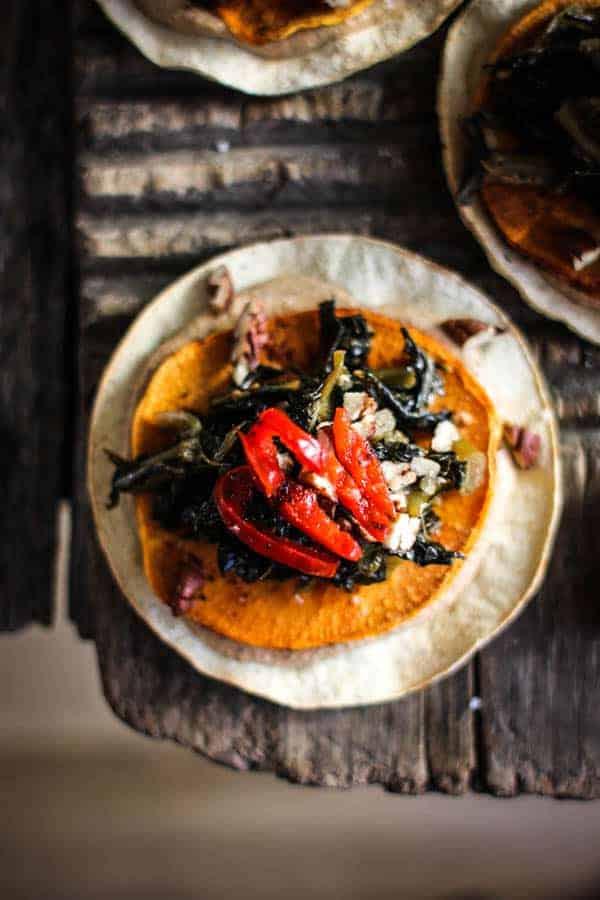 baked tostada with black-eyed pea hummus, roasted sweet potato, and jammy collard greens