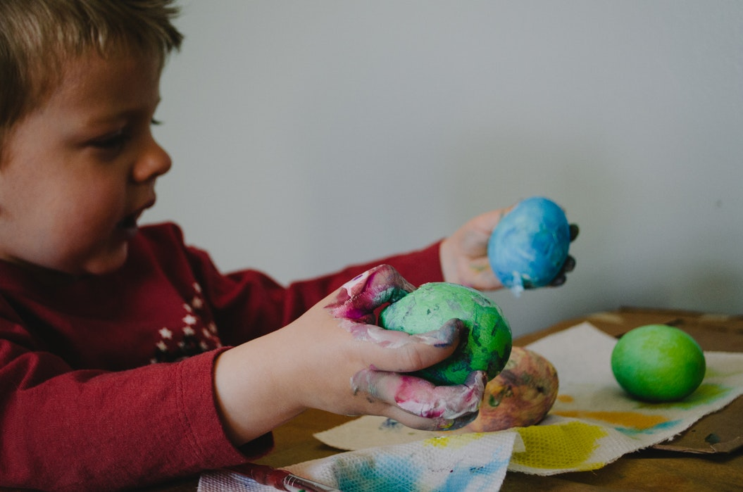 the benefits of play dough. child playing with play dough