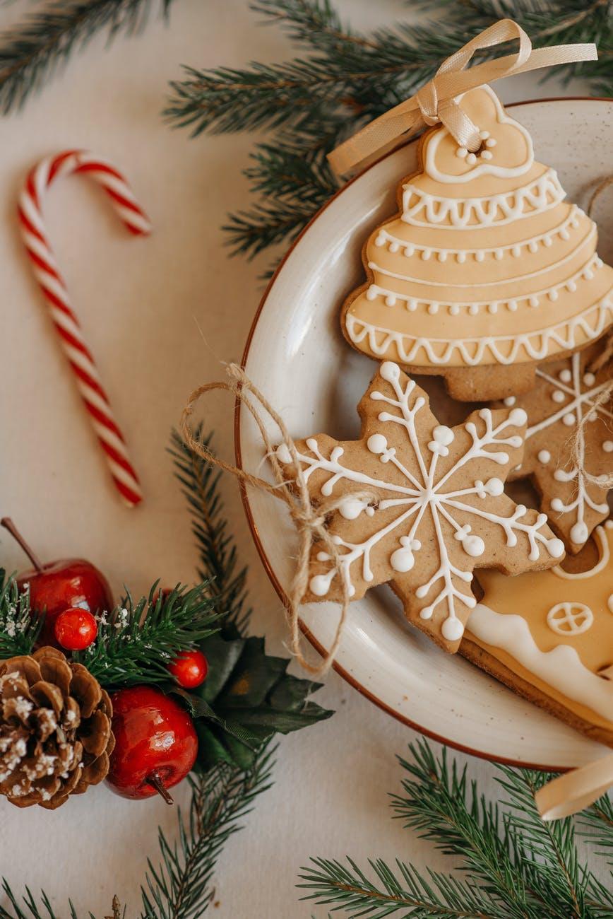 christmas cookies on white ceramic bowl