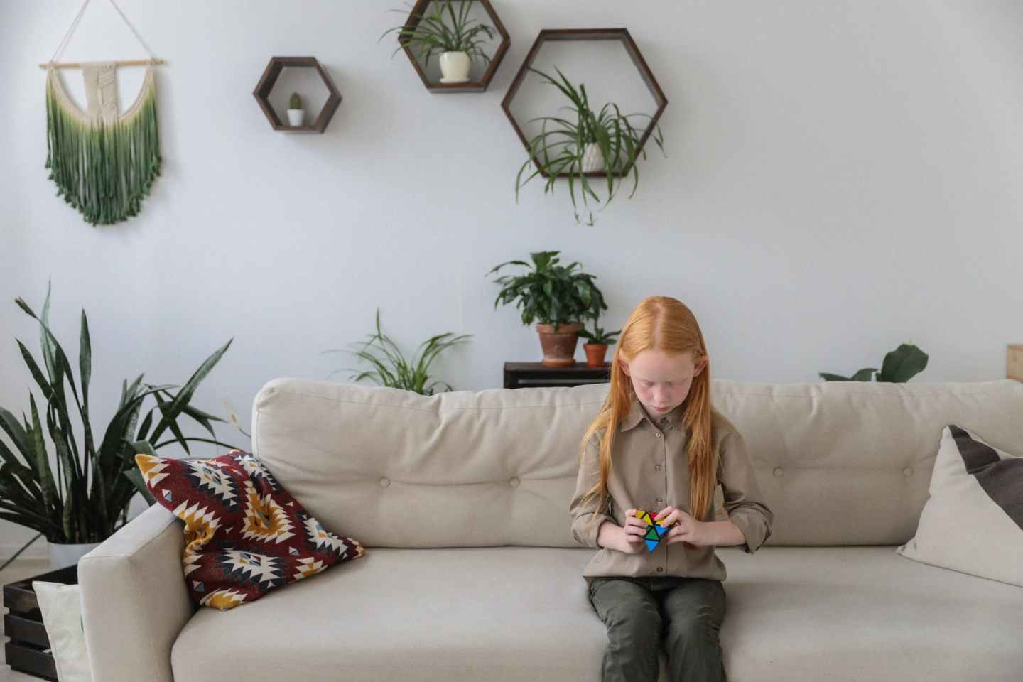 attentive girl with bright brainteaser in modern room