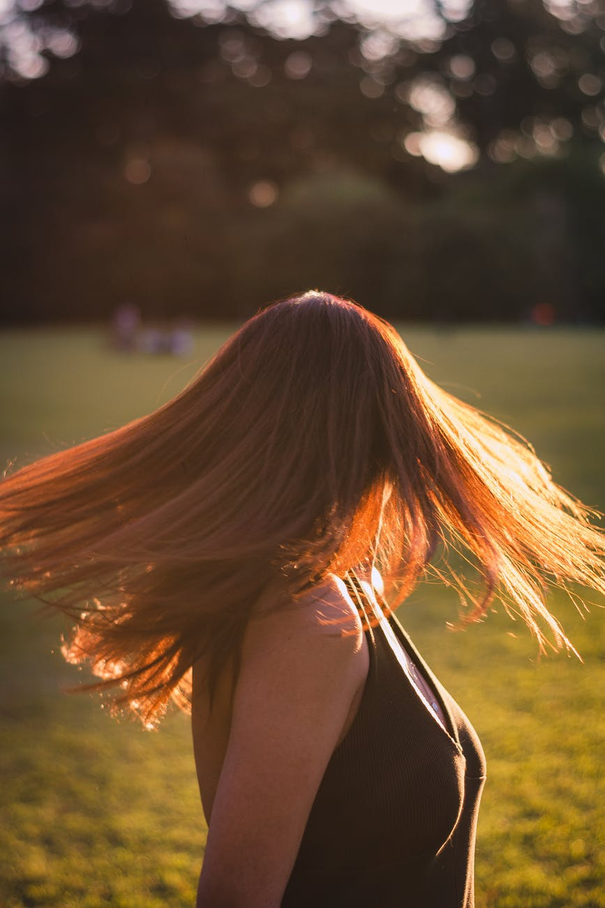 photo of woman swinging her hair