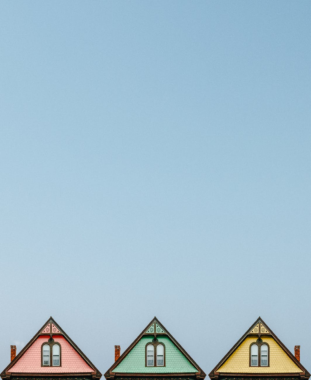 three pink green and yellow houses