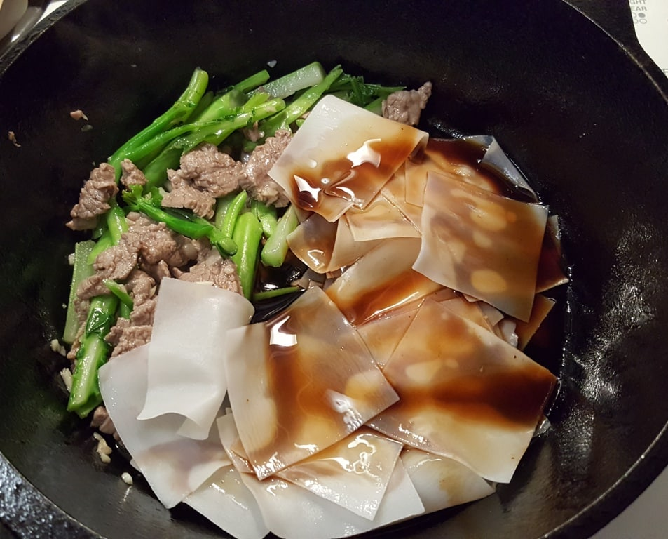 Carefully add in the Rice Flake Noodles and Most of the Sauce