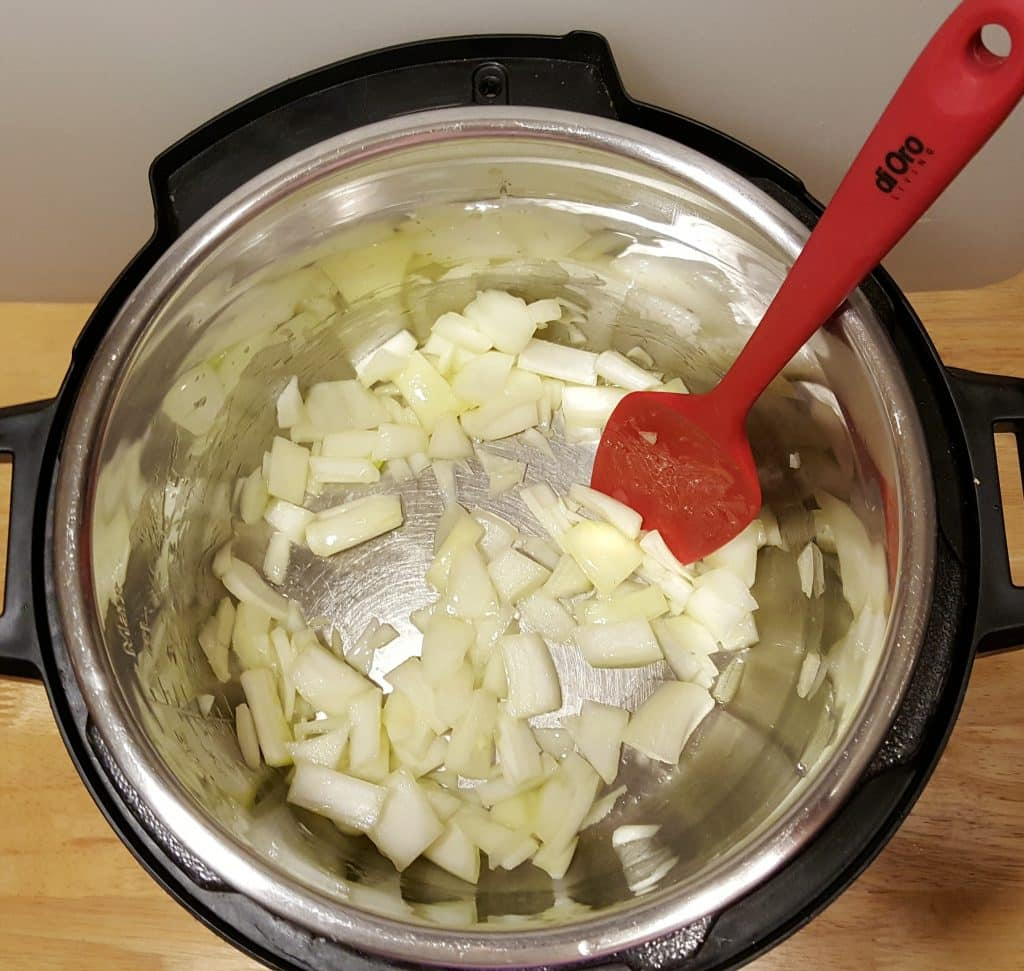 Heat Pressure Cooker, Add Oil and Onions