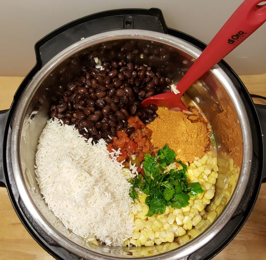 Add in the Beans, Seasonings, Corn and Rice Mexican Fiesta Bowl