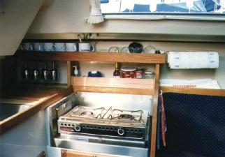 Above galley storage and a tamer stove