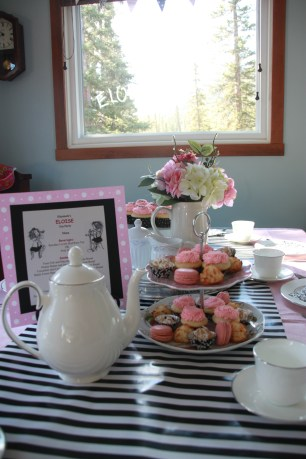 A menu for high tea, complete with pink drink and