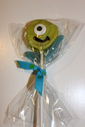 Party pops of Mike with Sully's big blue feet sour candies.