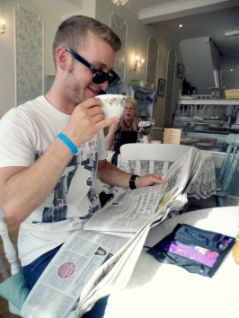 Glasses (kinda) - check, tea cup - check, little finger out - check newspaper - check JB's pretty much there