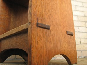 In closeup, it's easy to see the pin in the front face that holds the through tenon in place.