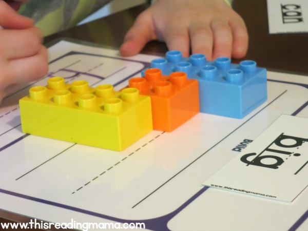 writing the word on the DUPLO handwriting mat