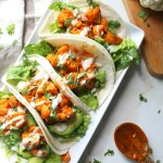 These Vegan Buffalo Cauliflower Tacos are packed full of spicy buffalo sauce, creamy ranch, crunchy romaine and hearty avocados | ThisSavoryVegan.com #thissavoryvegan #vegantacos