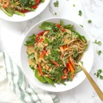 Raw veggies are tossed together with rice noodles and a tahini dressing in theseAsian Tahini Noodle Bowls. A quick vegan dinner or make ahead lunch | ThisSavoryVegan.com #thissavoryvegan #mealprep