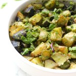 These Roasted Garlic and Pesto Potatoes are loaded with tons of fresh herbs - the perfect side dish for any time of year | ThisSavoryVegan.com #thissavoryvegan #potatoes #vegansidedish
