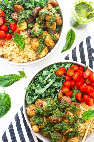 These Roasted Potato Kale Pesto Bowls are loaded with quinoa, cherry tomatoes, garlic potatoes and chopped kale - all topped off with vegan kale pesto | ThisSavoryVegan.com #thissavoryvegan #veganbowl #vegan