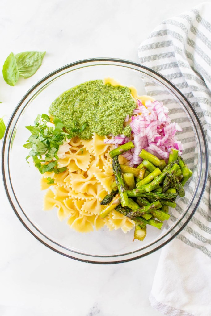 This Grilled Asparagus Pasta Salad is the perfect side dish for your next vegan BBQ. Homemade vegan pesto, crisp asparagus and chilled pasta | ThisSavoryVegan.com #thissavoryvegan #veganpastasalad #pestopastasalad