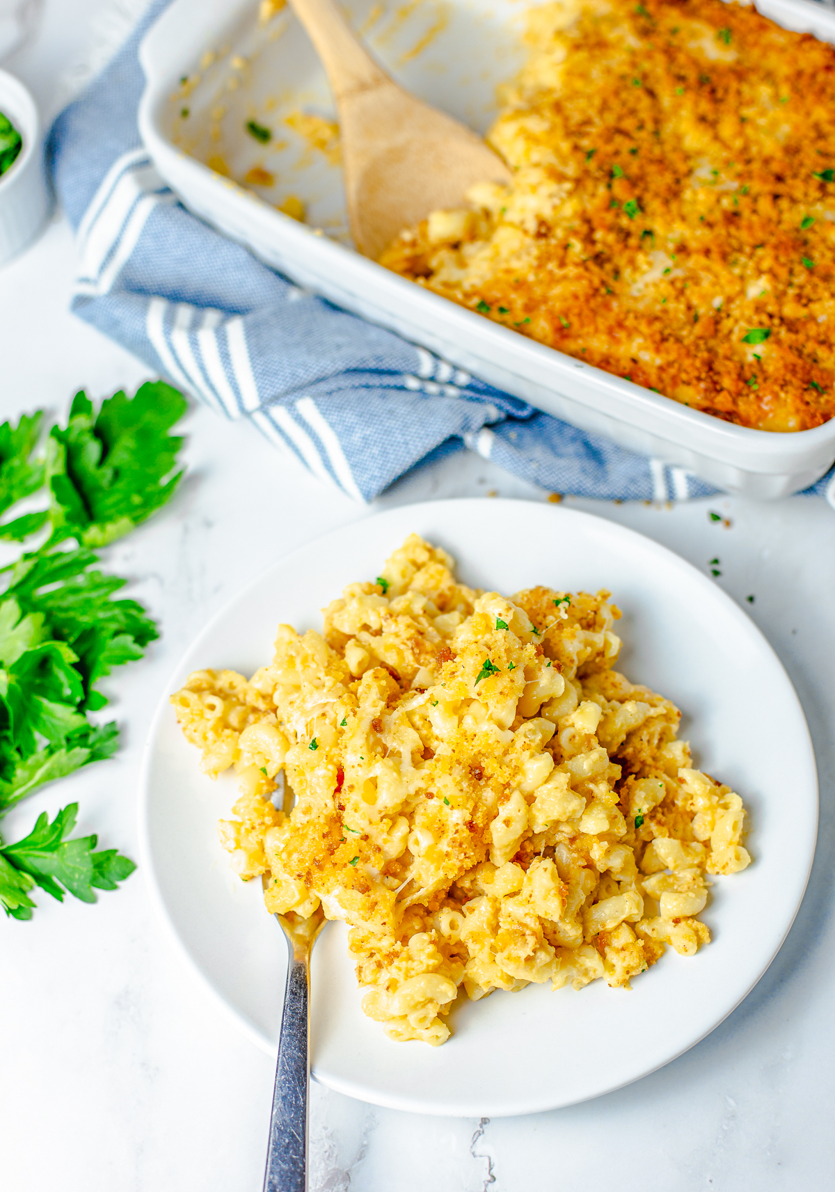 Overhead plate of Baked Macaroni and Cheese with Cornbread Crust on white plate with fork.